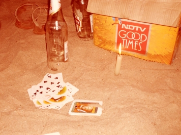 Good times... playing cards on Palolem Beach in Goa, India
